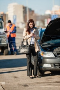 15529759-woman-on-the-phone-after-car-crash-breakdown-talking-upset